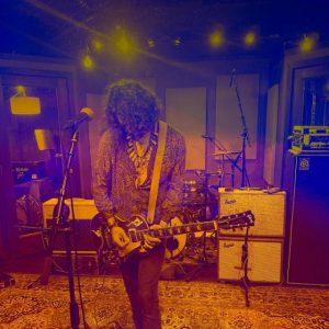 one man playing guitar